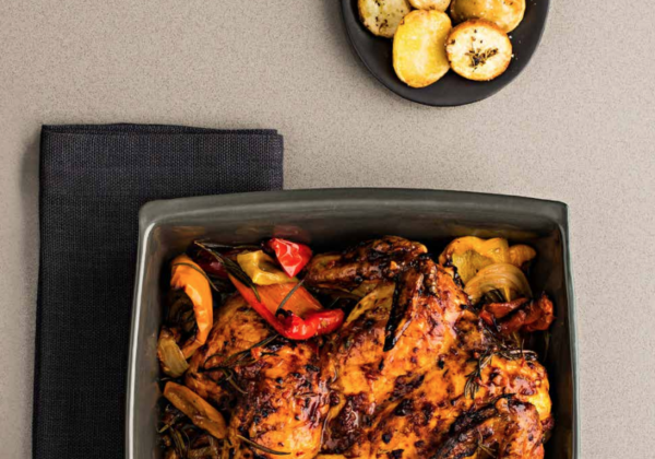 Butterflied chicken marinated with smoky pepper relish and chat potatoes